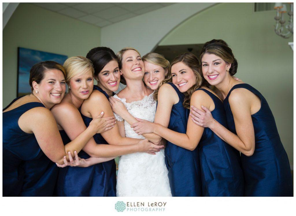 Bridesmaids hugging happy bride
