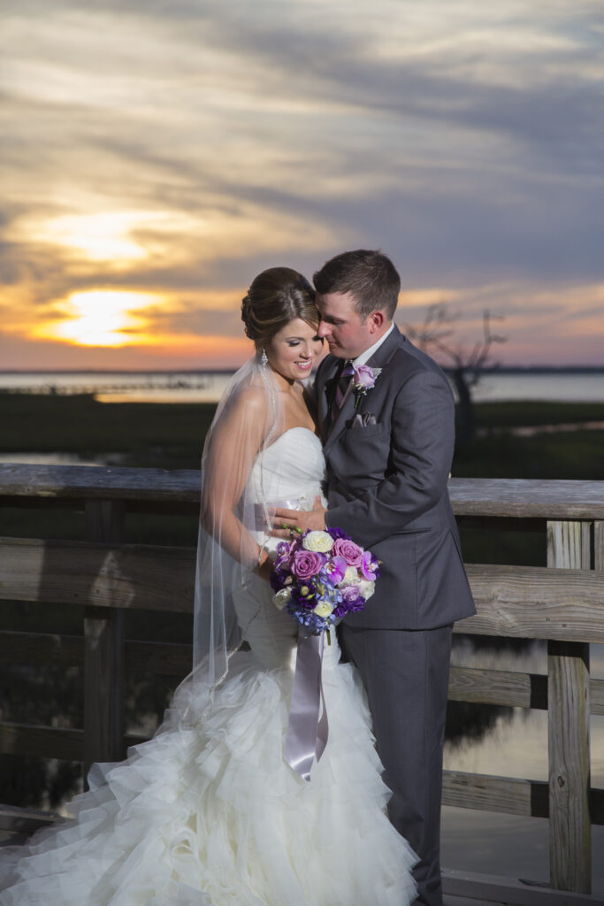 Sunset picture of bride and groom at NC Aquarium in Pine Knoll Shores