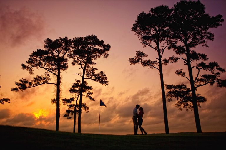 sunset engagement picture on golf course