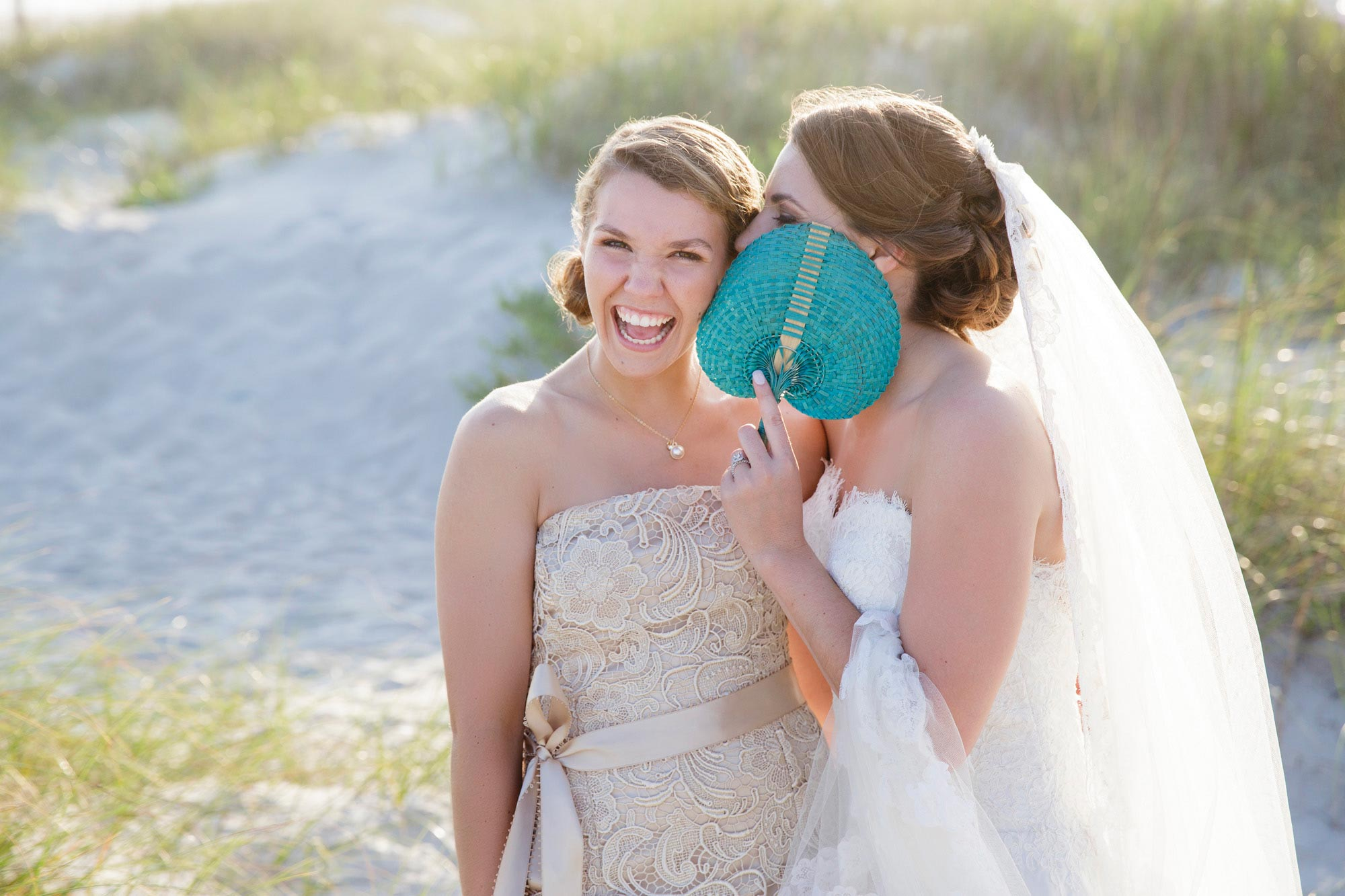 Cute picture of the bride with her sister on the beach at the Coral Bay Club in Atlantic Beach