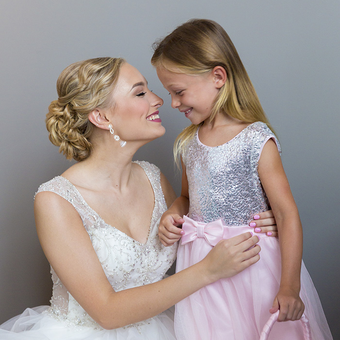 bride-cuddling-with-flower-girl