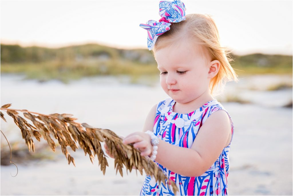Young girl explores sea oats in Emerald Isle NC